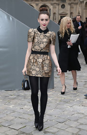Lily Collins opted for black tights instead of bare legs.