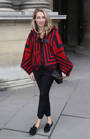 Alexandra Golovanoff sported a classic red and navy cape at the Louis Vuitton runway show in Paris.