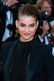 Barbara Palvin's demure smile was highlighted by her bold choice of lip color at the premiere of 'Behind the Candelabra' at Cannes.
