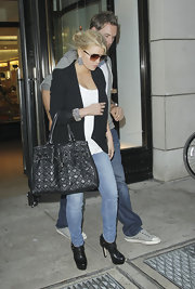 Jess showed off a dazzling pair of earrings while leaving Barney's in New York.