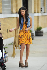 Jessica wore the ikat-printed Wild West Dress with clog heels and a denim vest.
