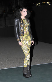 Never one for a subtle look, Jessie J brightened things up in a pair of bold yellow printed pants and a matching crop top.