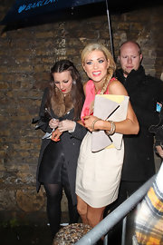 Nicola McLean styled her Club Pulse look by stacking three diamond-encrusted bangles on her wrist.