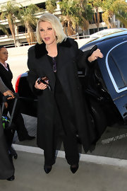 Joan Rivers kept her look classic and simple with this black trench with a fur-trimmed neckline.