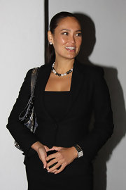 Tia Carrere's black-and-white pearl necklace looked perfect with her sophisticated skirt suit.