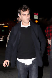 A sleek black blazer adds a pop of polish to Joaquin's disheveled ensemble.
