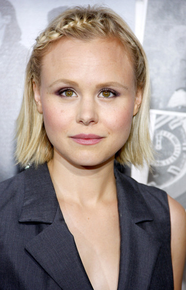 Alison Pill softened up her menswear-inspired look with a pretty pink lipstick.