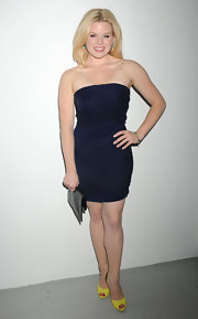 Megan Hilty added a pop of color with yellow peep-toe pumps.