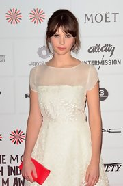 Felicity Jones chose a red leather clutch for the 2012 British Independent Film Awards.