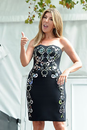 Nina Garcia oozed glamour at the 'Project Runway' fashion show in a gemstone-encrusted strapless LBD.