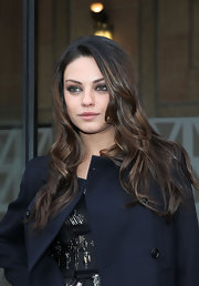 Mila Kunis attended the Miu Miu fashion show where she sported long tousled curls.