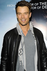 Josh Duhamel accessorized with a cotton and silk blend cross print scarf while out in London.