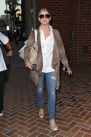 Julianne paired her distressed jeans with platform strappy wedges.