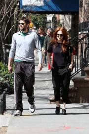 Julianne Moore stepped out in a classic black tee for a cool and casual look while out with her husband.