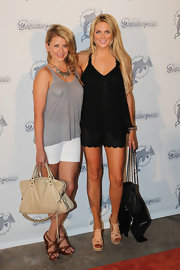 Stephanie Pratt supported the Miami Dolphins in nude platform sandals.