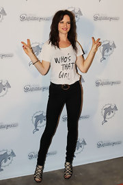 "Juliette rocks a t-shirt on the red carpet that reads ""Who's That Girl""."