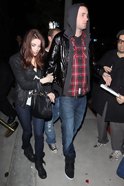 Ashley Greene toughened her streetwear with a pair of black leather motorcycle boots.