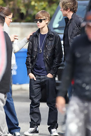 Justin mixes up his footwear with a pair of classic black converse sneakers while filming in Los Angeles.