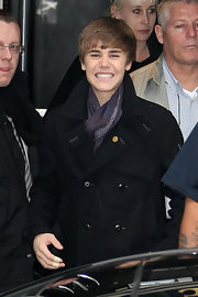 Justin wore a purple scarf with his black wool coat while out in Paris for his movie premiere tour.