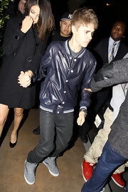 Justin wears gray leather lace-up high tops with velcrow lacing while out with Selena for his birthday.