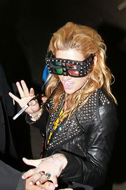 Kesha made a statement in stud-embellished shield sunglasses. She paired the offbeat shades with a matching studded leather jacket.
