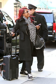 Kandi Burruss chose a basic wool coat with a matching belt for her casual street look while in New York.