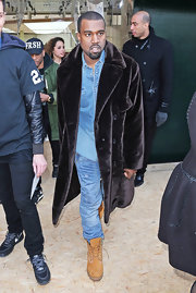 Kayne West has never been afraid to make a statement. Here, the rapper was spotted sporting a long fur coat at the Celine runway show in Paris.