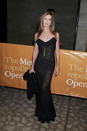 Holly graces the red carpet in a floor length lacy evening dress.