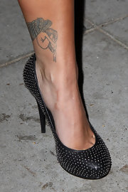 Kim Caldwell has a winged angel tattooed on her left ankle.
