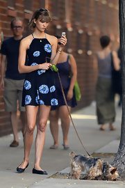 Karlie chose a bold daisy-print frock for her casual look while out walking her dog.