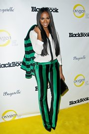 Tika Sumpter attended Fashion's Night Out wearing a boldly striped green and black pantsuit.