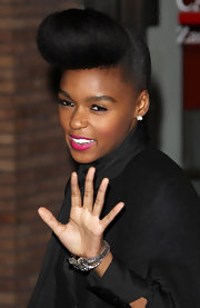 Singer Janelle monae finished off her look with a splash of hot pink lipstick. The perfect way to give her all black look some pop!
