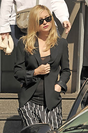Kate is the classic girl next door in black Ray-Ban wayfarers.