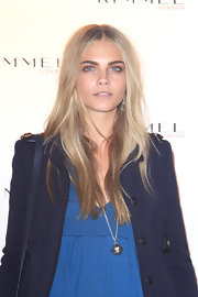Cara Delevingne wore a long chain necklace with a spiked sphere pendant at a party hosted by Rimmel.
