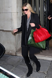 Kate Moss added a festive splash of color to her street style with a red leather tote.