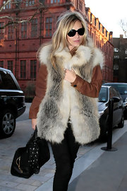 Kate Moss tied a star print scarf around her bag while out and about in London.