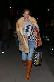Kate Moss' fur coat dressed up her casual jeans and t-shirt.