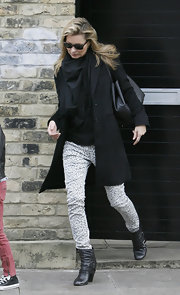 Kate Moss took a walk on the wild side in London in a pair of snow leopard skinny jeans.