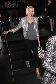Katherine Heigl embraced sparkle in a big way, layering a silver sequined blazer of a charcoal gray top.
