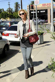 Katherine Heigl streamlined her street style with a white leather motorcycle jacket.