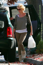 Katherine Heigl kept her look comfy and casual in a cropped gray and white striped top layered over a loose white tee.