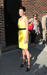 Katherine wore a vibrant yellow dress with a pair of patent Tribute sandals.