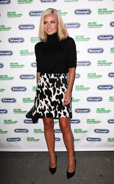 Katherine Jenkins pulled her look together with a pair of black patent leather pointy pumps.