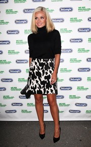 Katherine Jenkins paired a black-and-white print mini skirt with a turtleneck for a stylish look during the Macmillan De'Longhi art auction.