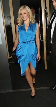 Katherine stepped out in a sleeveless sky blue draped dress.