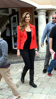 Katherine Webb brought some color to her all-black look with this vibrant red blazer.