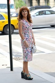 Kathy headed out in NYC wearing a paisley print sheath dress and funky green shoes.