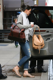 On another day out and about Katie Holmes was layered to perfection in her boyfriend jeans and scarf. She wore a cute pair of oxfords and paired then with a large hobo bag.