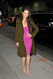 Katie struck a pose before her appearance on 'Letterman' in this olive military coat and hot pink dress.