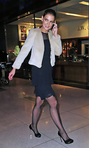 Kate Holmes matched the glamour of her sophisticated ensemble with a pair of black satin pumps with gold spike heels.